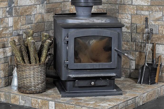 black_wood_burning_stove_landscape